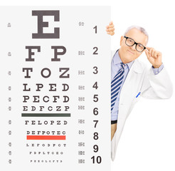 Male optician standing behind eyesight test