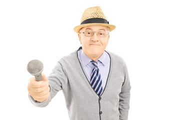Senior man holding a microphone
