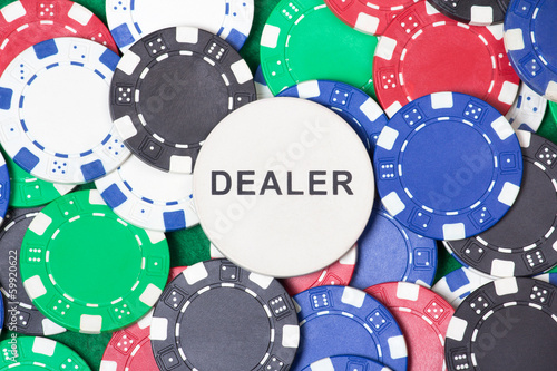 close up of colorful poker chips and big dealer chip