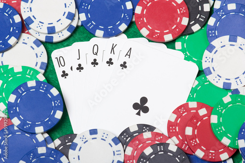 close up of a royal flush combination at poker with chips on the