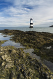 Penmon Beach, Anglesey, Wales with lighthouse.