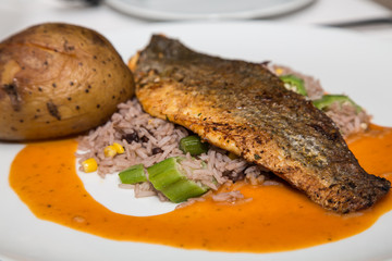 Baked Bass on Dirty Rice