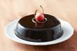 Whole chocolate cake on a dish