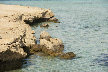 Rocky coastline detail in lagoon