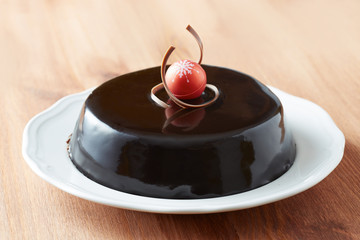 Whole chocolate cake on a dish