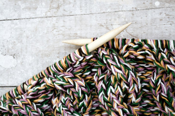 Knitting needles and yarn on wooden background