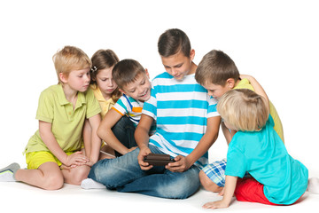 Group of six children with a new gadget