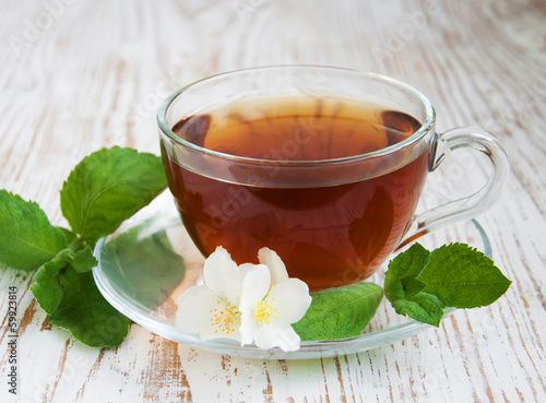 Tea and jasmine flowers and mint