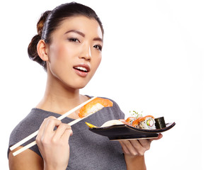 Beautiful young woman eating sushi. Isolated on white.