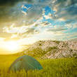 green touristic tent in a mountains