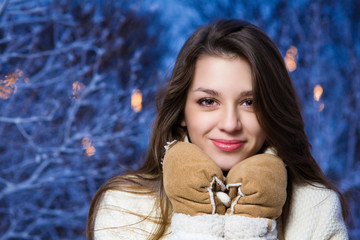 Portrait of young beautiful girl in winter park