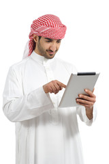 Arab man browsing a digital tablet
