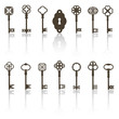 Collection of antique keys, keyhole with shadows.