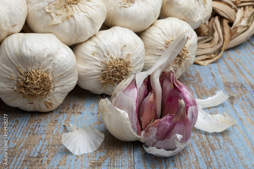 String of garlic on wooden background