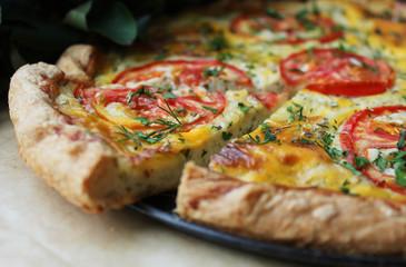 Slice of tomato and cream cheese pie