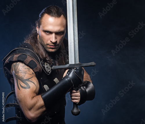 Young man with sword and historical costume