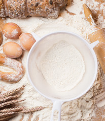 Cooking. White sieve with flour and bread