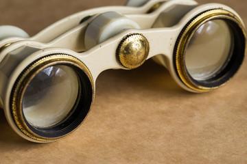 Opera, theater. White binoculars on the table