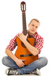Music. Young musician with a guitar on a white background