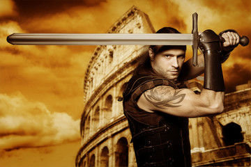 Lone gladiator with a longsword stands in front of Colosseum