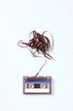 Audio cassette tape with subtracted out tape over blue textured