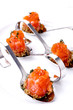 Salmon rolls with red caviar and bread crumbs Borodino