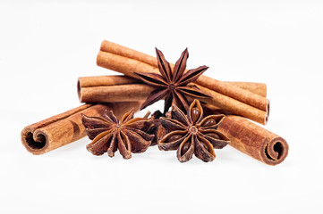 Cinnamon, anise and cloves on white background
