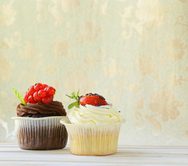 festive  cupcakes decorated with chocolate and berries
