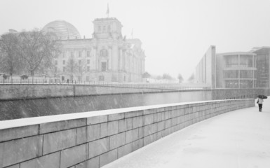 Winter in Berlin with walking People and The Reichstag building