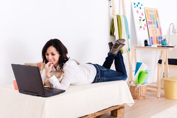 Woman working with her laptop in her living room