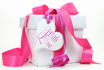 Beautiful pink and white gift box present on white