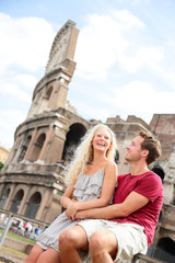 Tourist couple in Rome by Coliseum on travel