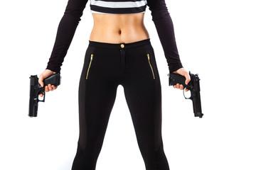 Dangerous female assassin holding two guns