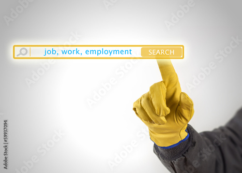 hand with protective gloves pressing search button