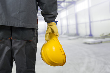 worker with helmet in production hall