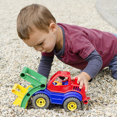 Child palying with toy car