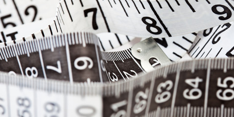 Measuring tape, symbol of tailoring and diets