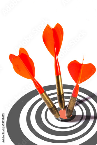 Three red darts in a dart board