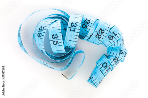 Blue measuring tape, shot from above, on white