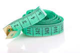 Green measuring tape, symbol of accuracy, on white poster