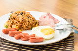 American fried rice with pork sausage, bacon and fried egg