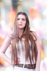 Beautiful model posing on stage, colorful background