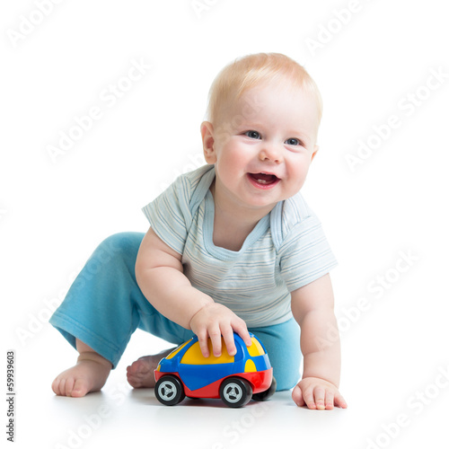 smiling kid playing with toy