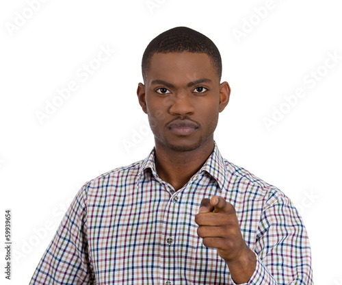 Confident serious man pointing index finger at you, camera