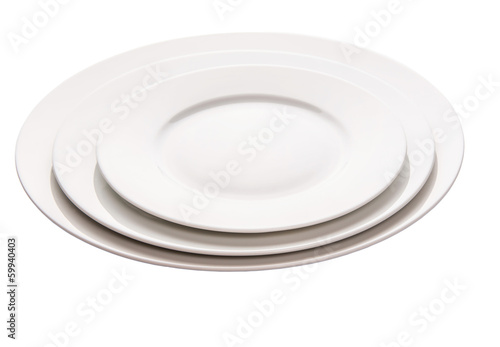 Empty plate with fork, knife and napkin on white background