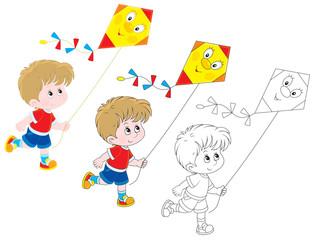 Little boy flying a funny kite