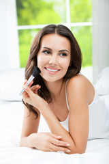 Smiling woman with make up brush, indoor