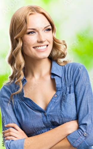 Happy smiling woman with long hair, outdoor