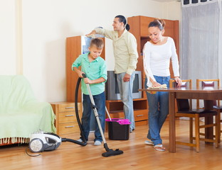 Ordinary family doing housework together