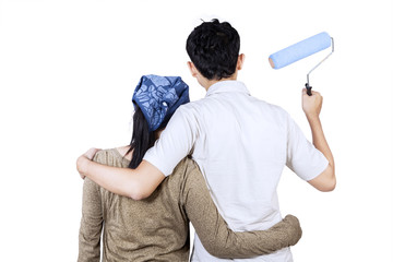 Couple ready to painting wall. isolated
